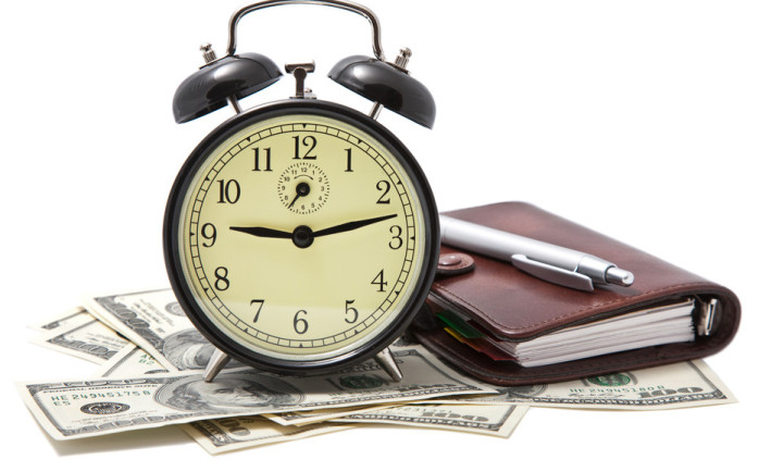 alarm clock and money isolated